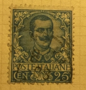 Effigy of Vittorio Emanuele III and floreal ornaments